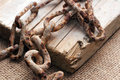 Rusty metal chain over grunge wooden surface Royalty Free Stock Images
