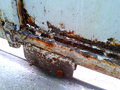Rusty metal door with wheel part of an olld Royalty Free Stock Photos