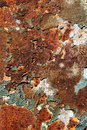 Rusty metal plate with old peeling paint for background or texture Royalty Free Stock Photography