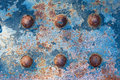 Rusty metal with rivets blue painted for background or texture macro shot Stock Photography