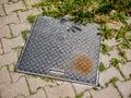 Rusty metal sewage cover close up shot Royalty Free Stock Photo