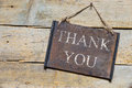 Rusty metal sign on wooden table, text thank you Royalty Free Stock Photo