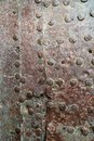 Rusty metal texture. Studded iron plate. Rivets on old rusty met Royalty Free Stock Photo