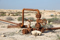 Rusty oil pipes in the desert of bahrain middle east Stock Photos