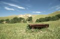 Rusty old cattle water trough near hills Stock Photo