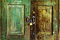 Rusty old green wooden door Stock Images