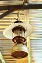 Rusty old kerosene lamp hanging Stock Photography