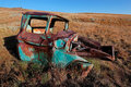 Rusty old pickup truck wreck of a out in the field Stock Images