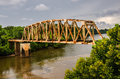 Rusty old railroad bridge spans the chattahoochee river on the georgia alabama border Stock Photo