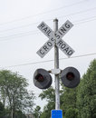 Rusty old railroad crossing signals in hdr at a rural area Stock Image