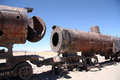 Rusty old steam locomotives at train cemetery bolivia the in uyuni desert south america Royalty Free Stock Image