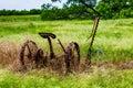 Rusty Old Texas Metal Farm Equipment in Field Royalty Free Stock Photo