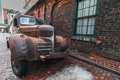 Rusty old truck at the distillery toronto parked beside brick walled building Stock Photos