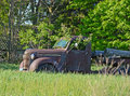 Rusty old truck with tree growing inside a cab Royalty Free Stock Image