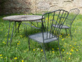 Rusty outdor furniture in the yard another view Royalty Free Stock Photo