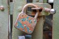 Rusty padlock that closes the scratch of an ancient prison o old bandits Stock Photo