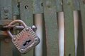 Rusty padlock that closes the scratch of an ancient prison o old bandits Stock Photography