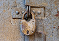 Rusty padlock on  metal door Stock Image