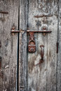 Rusty padlock on an old wooden door of the house indian Stock Images