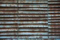 Rusty painted steel blades air ventilation protection grill text Royalty Free Stock Photo