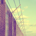 Rusty prickle wire fence outside barbed with blue sky vintage filter effect used Royalty Free Stock Photography