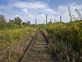 Rusty rails at abandoned industrial area Royalty Free Stock Photo