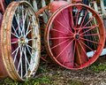 Rusty Red and White Wagon Wheels Royalty Free Stock Photo