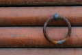 Rusty ring with the wall metal wooden Stock Image