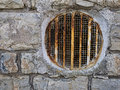 Rusty round window grille old air vent in old wall pre air con Stock Image