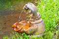 Rusty serpent fountain old found on a hiking trail Royalty Free Stock Images