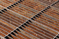 Rusty sewer grate on road Royalty Free Stock Photos