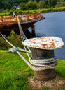 Rusty ship fixed in the harbour with ropes Royalty Free Stock Images