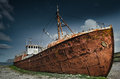 Rusty shipwreck stranded trawler in the westfjords of iceland Royalty Free Stock Photo