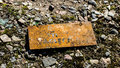 Rusty sign on the ground Royalty Free Stock Photo