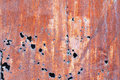 Rusty steel sheet with holes Stock Images