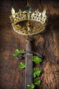 Rusty sword and golden crown Royalty Free Stock Photo