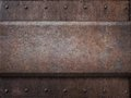 Rusty tank armor metal texture with rivets as Royalty Free Stock Photo
