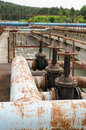 Rusty taps and pipes water treatment plant valves gate in dirty liquid bubble Stock Photography