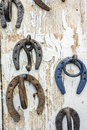 Rusty upside down horseshoes on wood panel Royalty Free Stock Photo