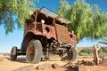 Rusty vintage truck under trees shot in namibia Stock Images
