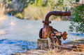 Rusty water pump on the bank of the tajo segura decanting Royalty Free Stock Image