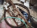 Rusty wheel bike in the garbage Stock Photos