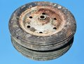 Rusty wheel an and old car on a blue background concept Royalty Free Stock Photos