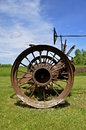 Rusty wheel of an old tractor displays the rear tireless with steel spokes Stock Image