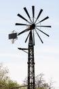 Rusty wind wheel and sunny sky Royalty Free Stock Photography