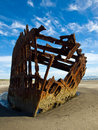 Rusty wreckage of a ship on beach on the oregon coast usa Royalty Free Stock Image