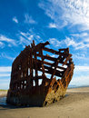 Rusty wreckage of a ship on beach on the oregon coast usa Royalty Free Stock Photography