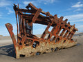 Rusty wreckage of a ship on beach on the oregon coast usa Stock Photos