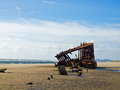 Rusty wreckage of a ship on beach on the oregon coast usa Royalty Free Stock Photo
