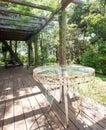 Rusty wrought iron table on sunny patio Royalty Free Stock Photo